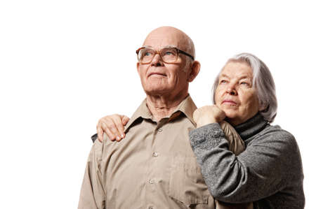 an old couple: Portrait of a happy senior couple embracing each other Stock Photo