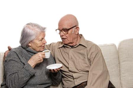 Senior couple drinking coffee photo