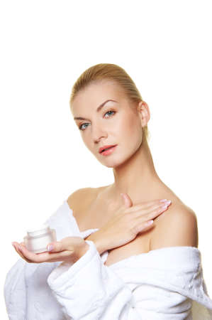 humidify: Woman applying moisturizer cream on her body