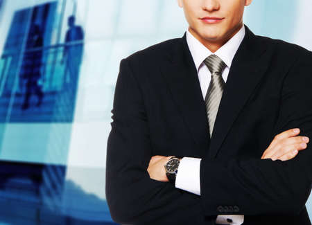 Young businessman against office building photo