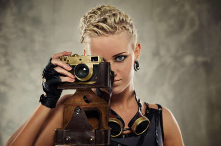 photocamera: Close-up portrait of a steam punk girl with a photocamera