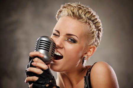 singer with microphone: Close-up portrait of a steam punk singer Stock Photo