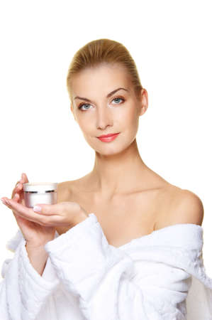humidify: Beautiful woman with bottle of cream Stock Photo