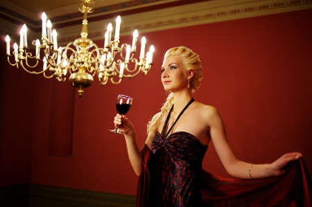Attractive lady with a glass of red wine photo