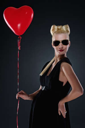 Attractive pregnant woman with a red balloon photo