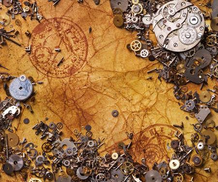 oxidado: Los engranajes antiguos en el papel con textura