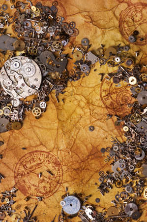 The old gears on the textured paper photo