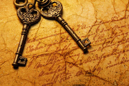 The old keys on the textured paper Stock Photo - 9102394