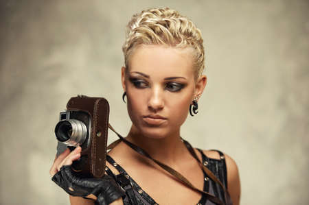 Close-up portrait of a steam punk girl with a photocamera photo