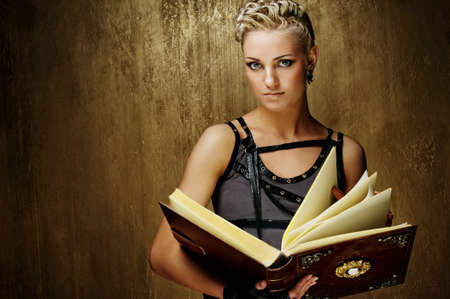 Steam punk girl with a book photo