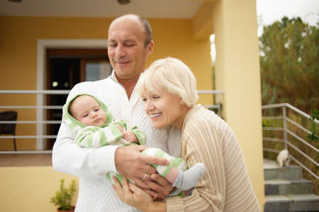 Grandparents with little child photo