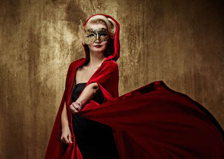 Beautiful lady in carnival mask photo