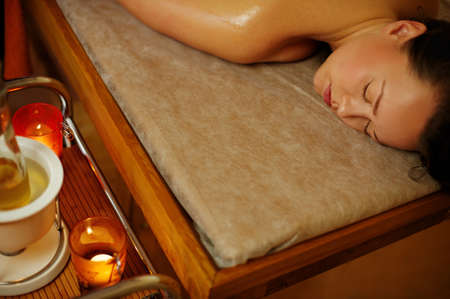 Beautiful woman relaxing in a massage salon Stock Photo - 9102388