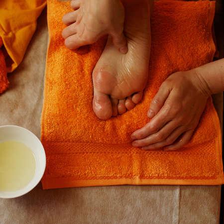 oil massage: Foot massage Stock Photo