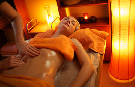 lying on the stomach: Beautiful woman having a massage Stock Photo