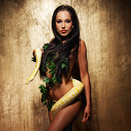 Attractive brunette woman with python Stock Photo - 9102410