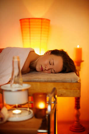 Beautiful woman relaxing in a massage salon Stock Photo - 9102317