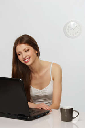 Beautiful brunette woman with laptop photo