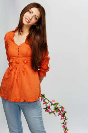 Beautiful brunette woman with a flowers photo