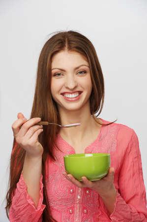 Beautiful brunette woman having a breakfast photo
