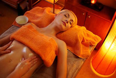massaging: Beautiful woman having a massage Stock Photo