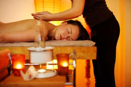 back massage: Beautiful woman having a massage Stock Photo