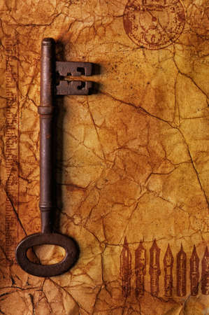 The old key on the textured paper photo