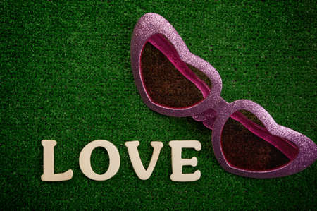 The word love written on green background photo