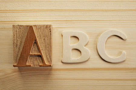 English letters on wooden background Stock Photo - 9252634