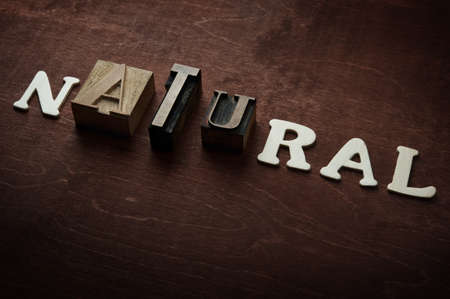 The word natural written on wooden background photo