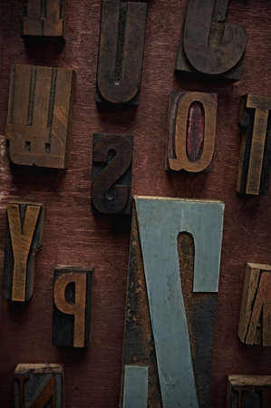 Vintage letters on wooden background Stock Photo - 9252641