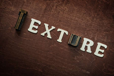 The word texture written on wooden background Stock Photo - 9252681