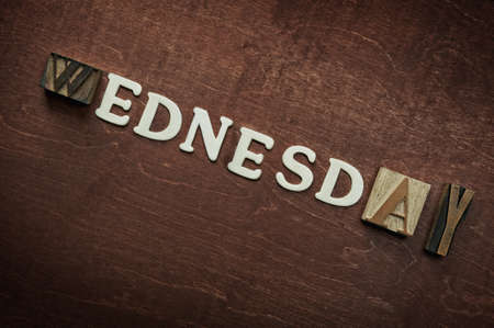 The word wednesday written on wooden background Stock Photo - 9252652