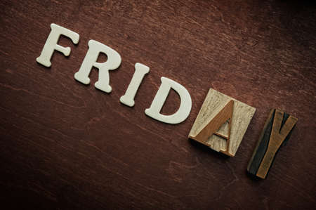 letterpress words: The word friday written on wooden backgroun