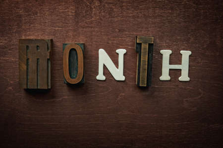 The word month written on wooden background photo