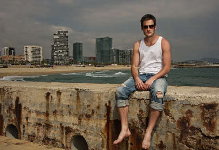 Handsome man near the sea photo
