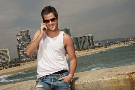 Handsome man near the sea Stock Photo - 9418248