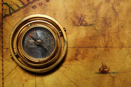 topography: Vintage compass on the old map Stock Photo