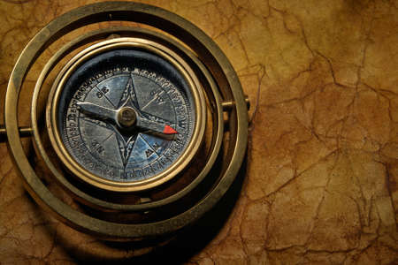Vintage compass on the old textured paper photo