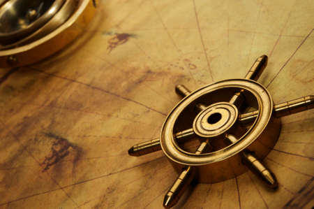 rudder ship: Steering wheel on the old map Stock Photo
