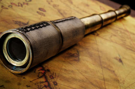 Close-up of a spyglass on the old map Stock Photo - 9418157
