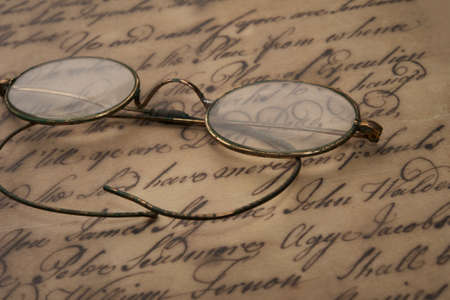 old macro: Old glasses on the vintage document