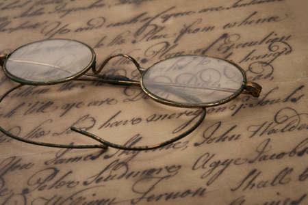 spec: Old glasses on the vintage document