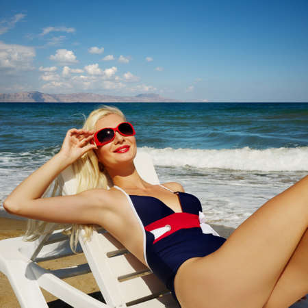 Blond woman relaxing near the sea photo