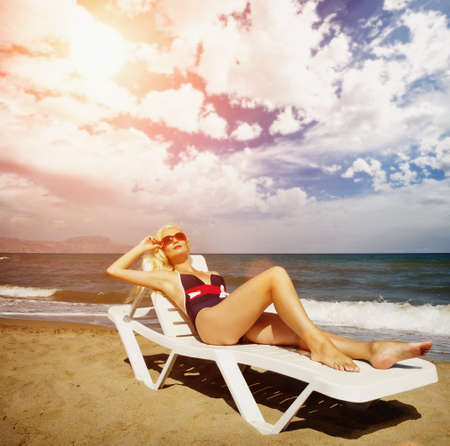 Blond woman relaxing in the sea photo