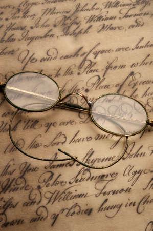 bifocals: Old glasses on the vintage document