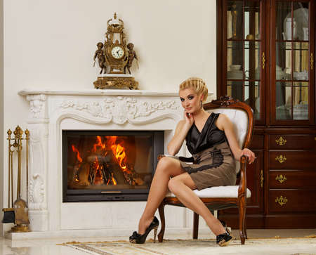 Beautiful blond woman in a luxury interior Stock Photo - 9904798