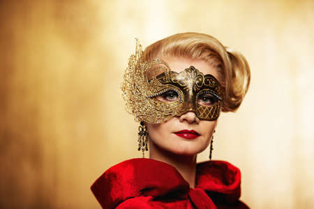 Beautiful lady in carnival mask photo