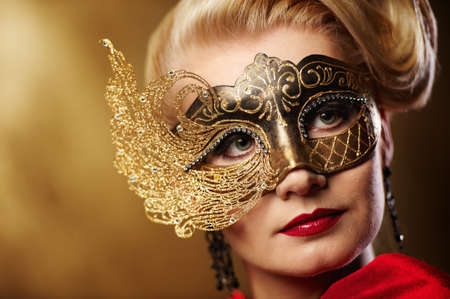 Close-up portrait of a beautiful woman in carnival mask photo