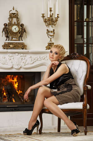 Beautiful blond woman in a luxury interior Stock Photo - 9657893